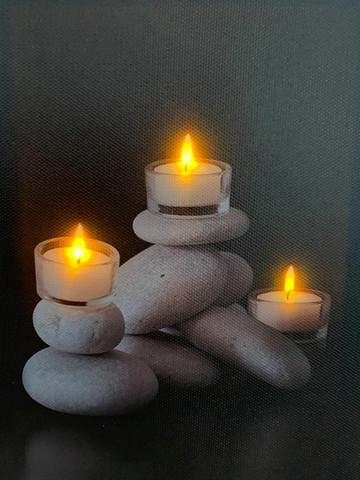 Pikku led-taulu Zen-tuikut kivellä