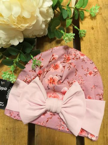 Vaaleanpunainen Kirsikankukka rusettipipo