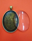 Pendant base, oval, with glass cabochon, c. bronze