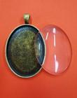 Ramberlock, oval, med glascabochon, bronsfärgad