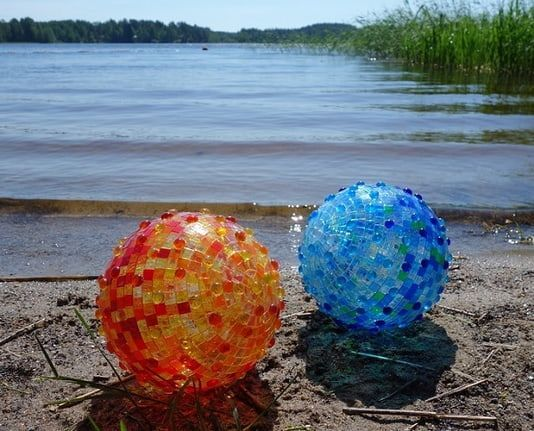 Beutiful mosaic balls on the beach.