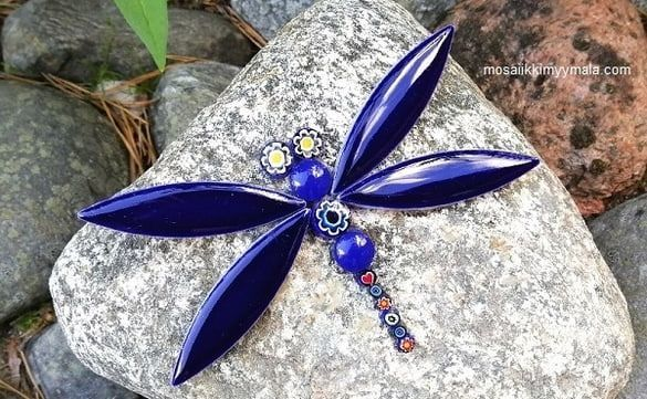 Gorgeous mosaic dragonfly on a stone.