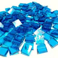 T063 Capriblau, transparent, 1x1 cm, 200 g