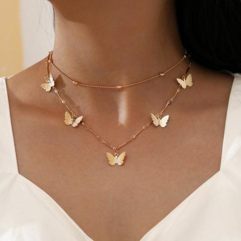 Kerroskaulakoru, FRENCH RIVIERA Delicate Butterfly Necklace in Gold