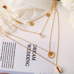 Kerroskaulakoru, FRENCH RIVIERA|Delicate Seashell Necklace in Gold