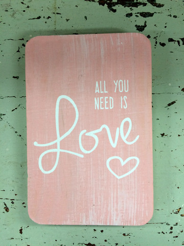 Puinen kyltti 1:  All you need is love