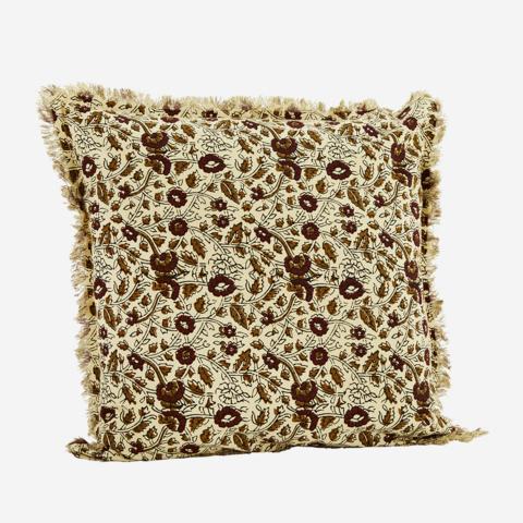 Tyynynpäällinen hapsureunoilla, kermanvaalea kuvioilla. 50x50