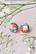 Nappis-korvakorut. Puna-valko kukallinen