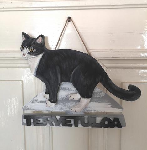 Mustavalkoinen kissa kyltti