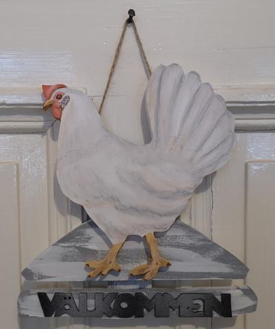 Valkoinen kana Välkommen kyltti