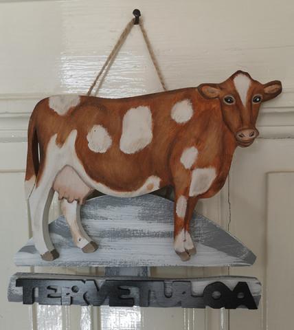 Ruskeavalkoinen lehmä kyltti