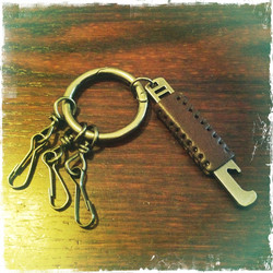 Leather key fob with metal decoration bottle opener
