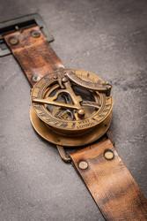 Wrist sundial with compass