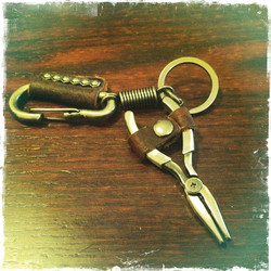Leather key fob with metal decoration pliers