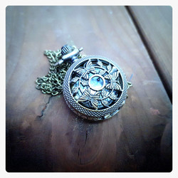 Small battery pocket watch with decor