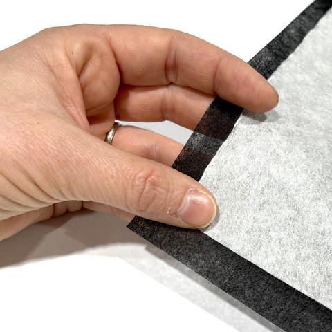 Vlieseline: Stitch-n-tear, revittävä tukikangas, musta ja valkoinen