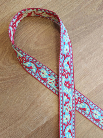 Vävt band 20 mm, blomranka, röd/gul/ljus turkos