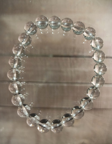 Vuorikristalli rannekoru, hiotut 8 mm kivihelmet