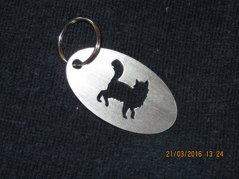 Keychain oval cat is coquettish