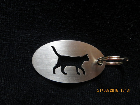 Keychain oval cat walks short-haired