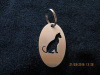 Keychain oval cat sitting short-haired