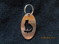 Keychain oval cat sitting long-haired