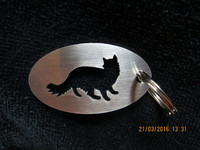 Keychain oval cat stands long-haired