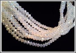 Kristallilasirondelli 6 x 4 mm, fasetoitu opaalivalkoinen, ½ nauha