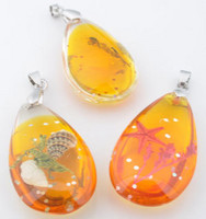 Korunosa Pinkki/oranssi riipus meriaihe