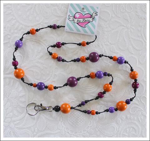 Avainkaulanauha, violetti/oranssi/musta