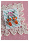 Rusetti-korvakorut, oranssi