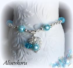 3934,1 Alise Design  Käsikoru siipien suojassa helmi / kristalli VALITSE VÄRI