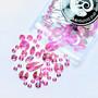 Erimuotoisia vaaleanpunaisia kimmeltäviä ihotimantteja
