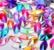 Sekoitus värikkäitä ovaalinmuotoisia AB-ihotimantteja