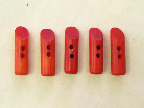 Puhvelinluunappi, pitkula, 32mm, punainen