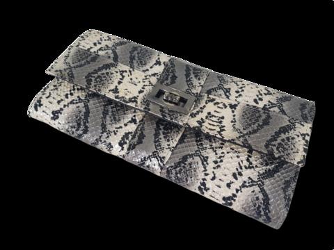 Käsilaukku (käärmeennahkajäljitelmä)