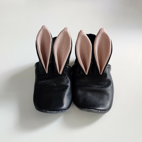 Mannankylässä Children's bunny slippers black genuine leather, pink ear interior.