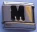 M, musta
