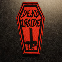 Dead inside coffin patch, red