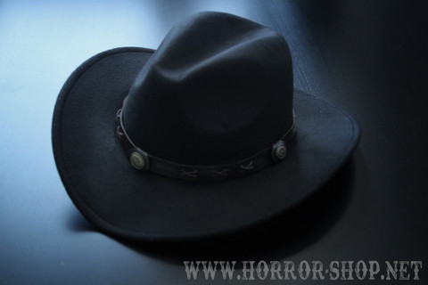 black cowboy hat (with leather band, could be different than in the pic)