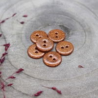 Atelier Brunette glitterkoristeltu helmiäisnappi 12mm punaruskea