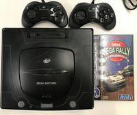Sega Saturn -konsoli + 2 ohjainta ym.