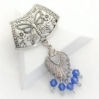 perhonen kimaltavilla lasihelmillä sininen