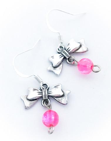 rusettikorvakorut pinkillä helmellä