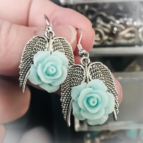 pikkusiipi korvakorut ruusulla sininen