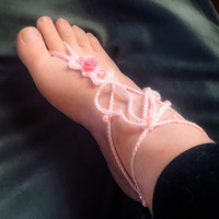 suloinen pinkki jalkakoriste