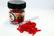 Keinotekoinen punainen kärpäsentoukka