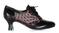 Musta nahkainen kävelykenkä punaisella pallokuosilla