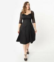 Musta hihallinen mekko