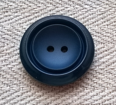 Sininen takinnappi, 23 mm